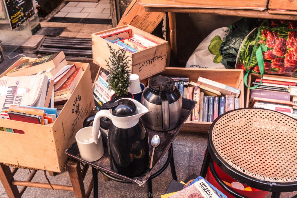 Coffee and books stacked outside